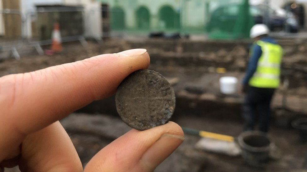 Finds included coins. AOC ARCHAEOLOGY