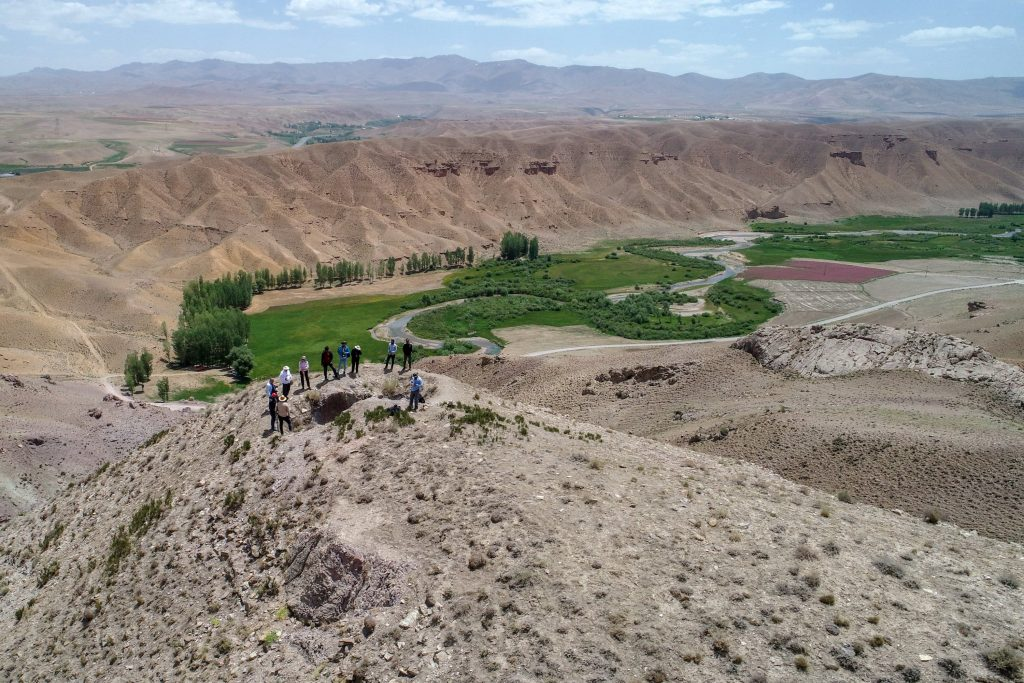 Archaeologists examine the remains of the castle on the mountain. Photo: AA
