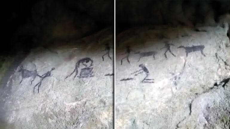 """The cave's walls are adorned with drawings showing a """"hunt"""" for animals resembling cows and how to breed them.  Photo: İHA"""