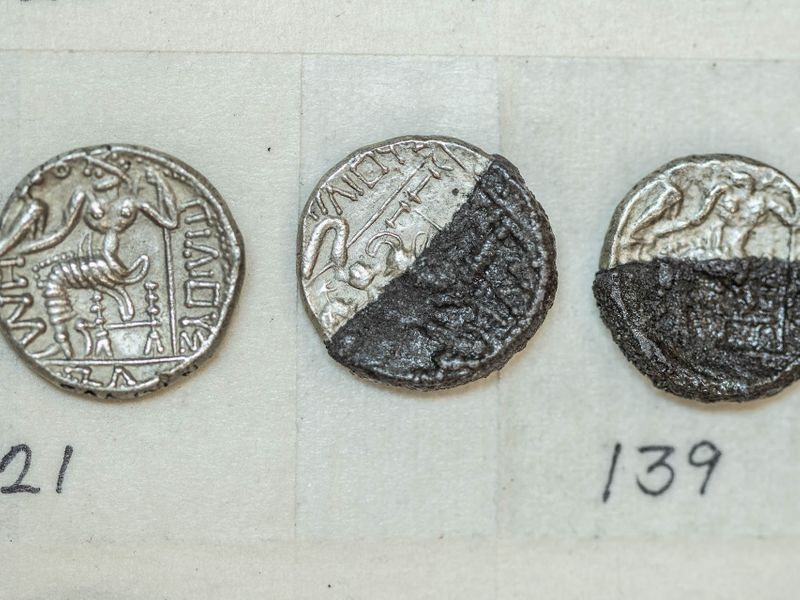 According to Sharjah Archaeology Authority, the first issues of the minted coins depicted icons of that period, including the head of Hercules (represented by Alexander the Great) and Zeus (the Greek god sitting on his throne), in addition to the word 'Alexander' engraved in Greek script.