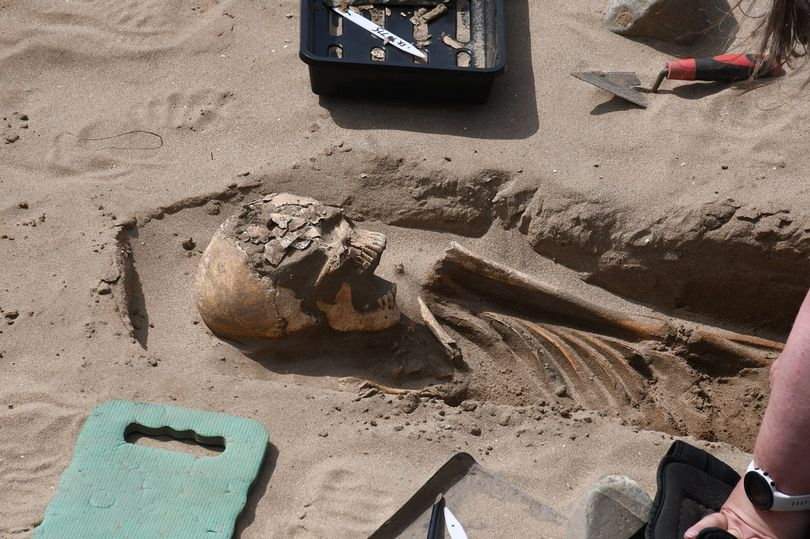 A skeleton has been uncovered by archaeologists working at St Patrick's Chapel in Pembrokeshire (Image: Nick Bolton)