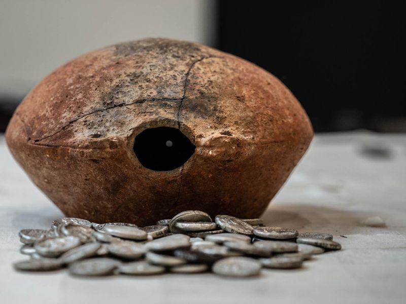 The coins were contained in an ancient jar.