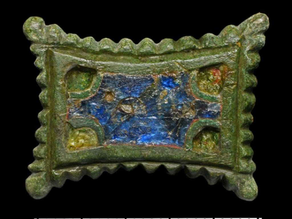 Enameled non-ferrous metal rectangular brooch — clasp with retracted sides from the Carolingian era. (Landesamt fur Denkmalpflege und Archaologie Sachsen-Anhalt, Friederike Hertel/Zenger News)