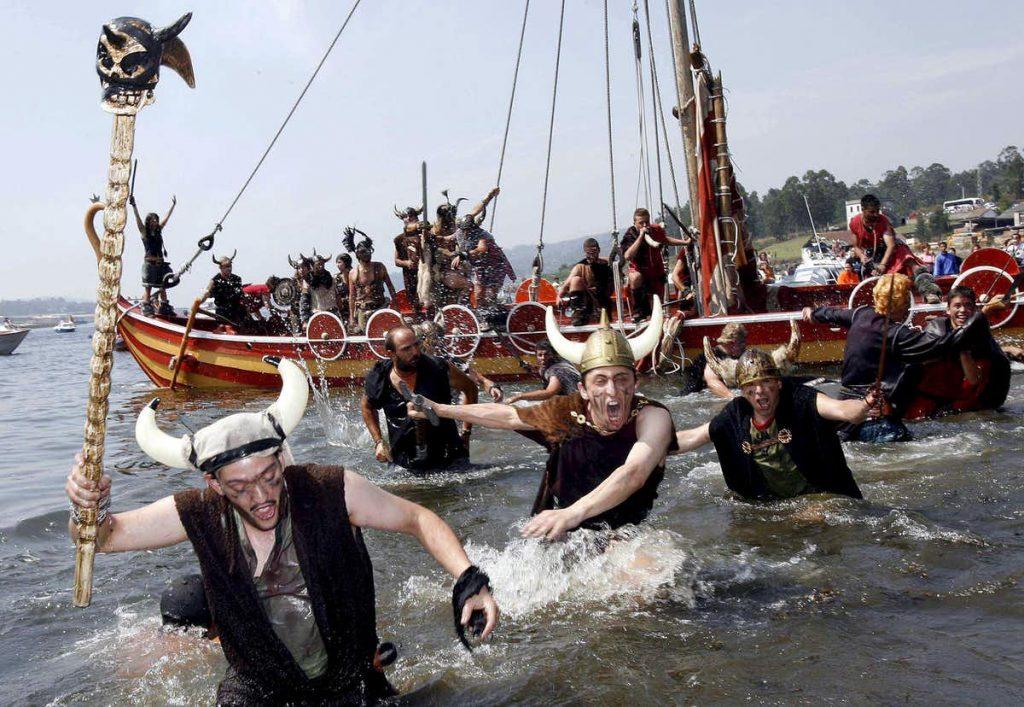 It's a raid: Catoira residents dressed as Vikings swarm ashore from their longship. EPA/Salvador Sas