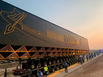 A smart vehicle transports Pharaoh Khufu's boat, which dates back some 4,600 years, early Saturday, Aug. 7, 2021 from the Giza Pyramids to the soon-to-complete Grand Egyptian Museum. (AP Photo)