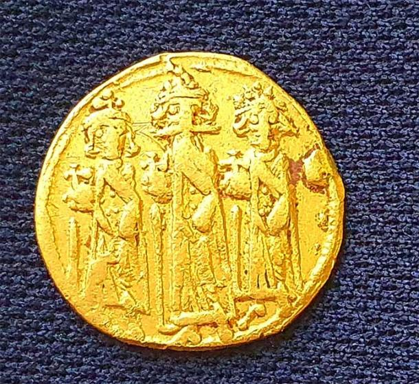 The gold coin unearthed in the excavation was minted in either 638 or 639 AD when ancient Palestine was part of the Byzantine Empire ruled by Emperor  Heraclius. (Amir Gorzalczany /  Israel Antiquities Authority )