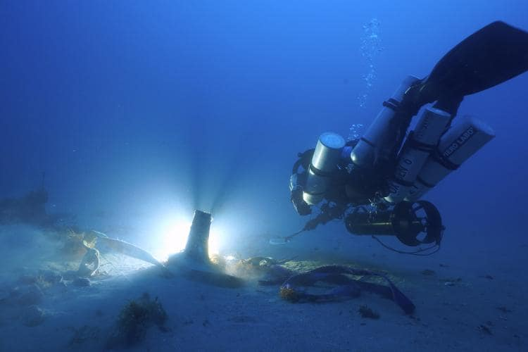 Diver with ancient ram discovery, Sicily, Italy. Photo by Mario Arena