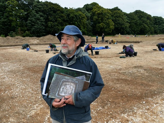 """Dr Peter Halkon, Senior Lecturer in Archaeology at the University of Hull, at the """"shrine"""" site - those in the background are working on an entranceway to the fort"""