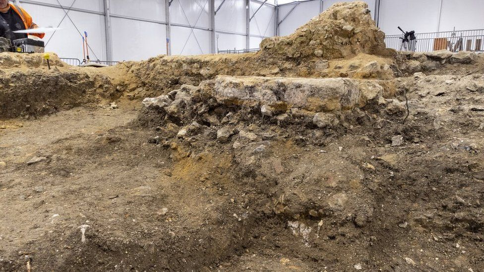 Flint walls found by archaeologists are believed to have formed part of an Anglo-Saxon church