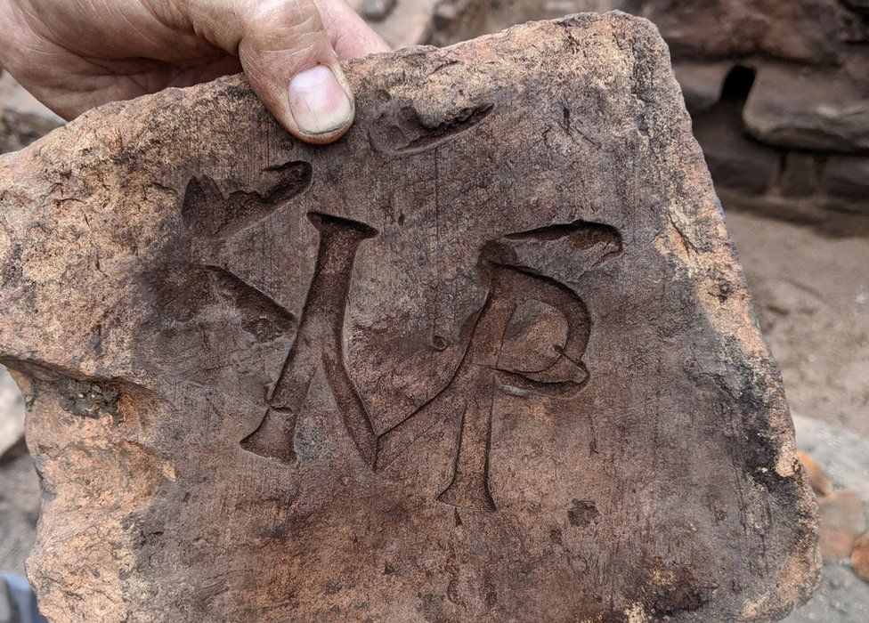Archaeologists say the IMP stands for imperator, Latin for emperor