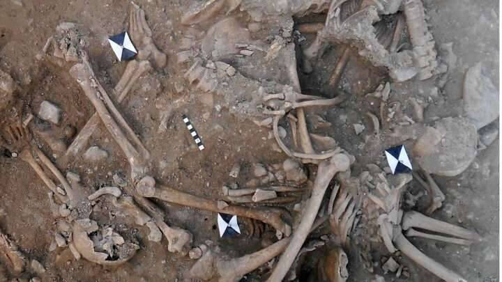 The two mass graves contain the remains of at least 25 men. (Image credit: Claude Doumet-Serhal)