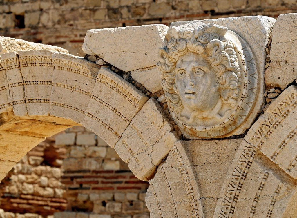 A carved Gorgon head on arches surrounding the Severin forum, in the ancient Roman city of Leptis Magna near the coastal city of al-Khums, Libya. (AFP Photo)