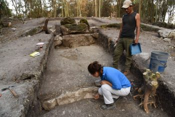 Melina García (front) excavates the central part of Aguada Fenix, the largest and oldest Maya monument ever uncovered. A team of UArizona researchers reported on the discovery in 2020